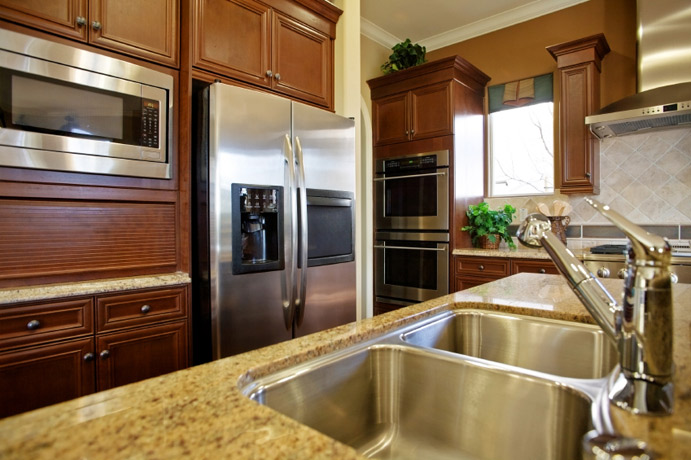 Granite-Kitchen-Countertop-tan-mahogany-cabinets.jpg Superb Stone